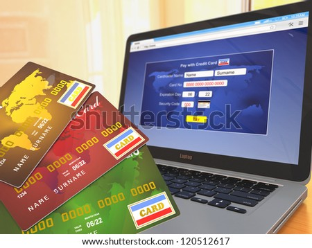 E-commerce. Credit cards on laptop. Three-dimensional image. - stock photo