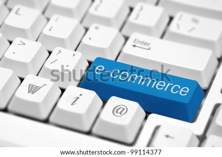 e-commerce key on a white keyboard closeup. E-commerce concept image. - stock photo