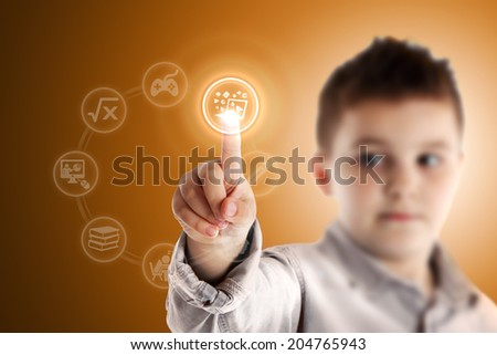 E-learning. Boy pressing a virtual touch screen. Orange background. - stock photo