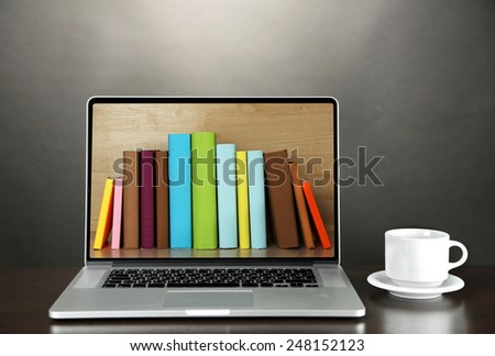 E-learning concept.  Digital library - books inside laptop - stock photo