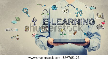 E-learning concept with young man holding a tablet computer  - stock photo
