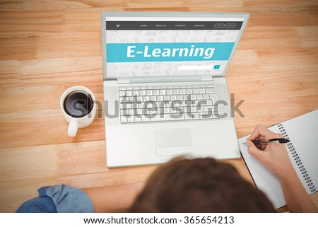 E-learning interface against hipster writing on spiral notebook by laptop at desk in office - stock photo