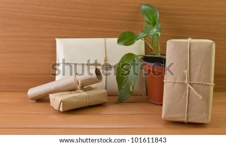 e-mail box with a flower on a background of wood - stock photo