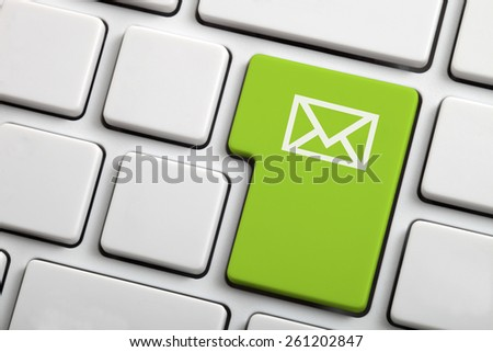 E-mail envelope in a green computer key - stock photo