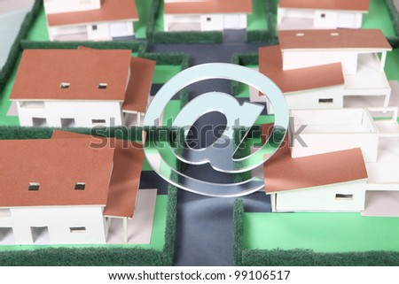 E-mail symbol above model housing - stock photo
