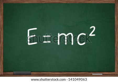 E=mc2 formula written on chalkboard - stock photo