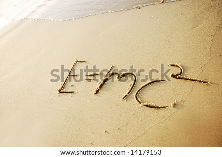 E=MC2 written in sand Theory of Relativity - stock photo