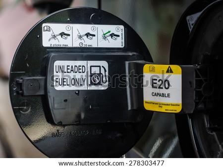 E20 Petrol car fuel tank cover opened. - stock photo