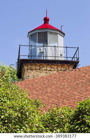 Eagle Bluff Lighthouse, built in 1868, is located near Fish Creek in Peninsula State Park in Door County, Wisconsin. - stock photo