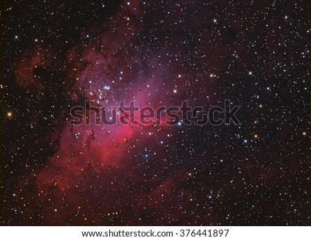 Eagle Nebula M16 in Serpens taken with CCD camera through medium field telescope - stock photo