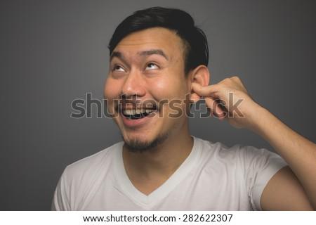 Ear picking. - stock photo