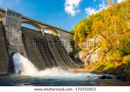 Early autumn color and Prettyboy Dam, on the Gunpowder River in Baltimore County, Maryland. - stock photo