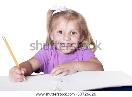 Early childhood education. Cute smiling little girl learning to write. - stock photo