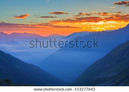 early misty morning in a mountains - stock photo