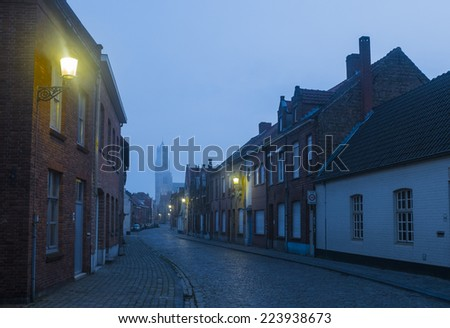 Early Monring ion a back street n Bruges, Belgium - stock photo
