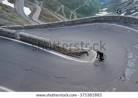 Early Morning Alpine Cycling  - stock photo