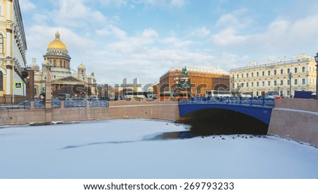 Early morning at winter Saint Petersburg. View from Moika embankment to the St Isaac's Square, Blue Bridge and hotels - stock photo