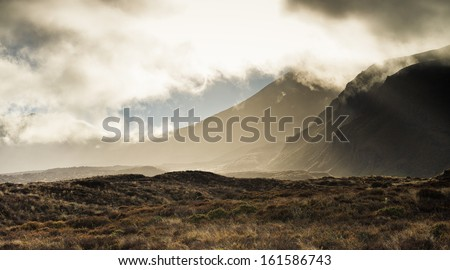 Early morning cloud on Mount Ngauruhoe, Tongariro National Park, New Zealand - stock photo