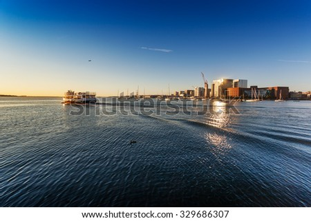 Early morning commuter ferry leaving Boston Harbor, Boston, Massachusetts - stock photo