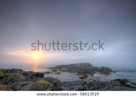 Early morning fog along the Atlantic coastline. - stock photo