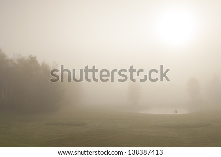 Early morning fog on a golf course, Stowe Vermont, USA - stock photo