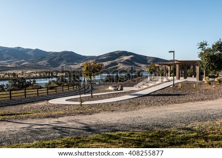 Early morning light on amphitheater with Lower Otay Lake and mountain range in the background at Mountain Hawk Park in Chula Vista, California.  - stock photo