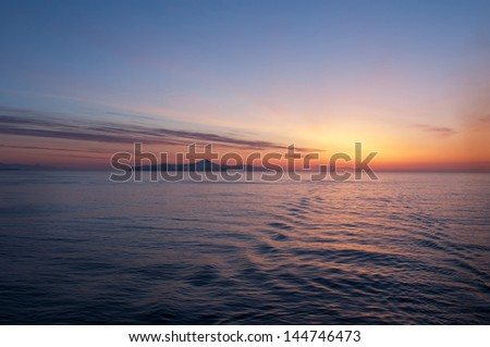 Early morning light on the ocean - stock photo