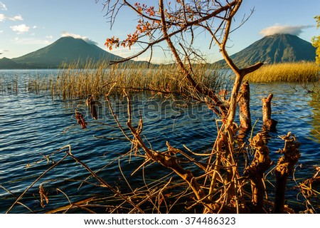 Early morning light on volcanos San Pedro & Toliman on Lake Atitlan, Guatemala. Photo taken from Santa Cruz la Laguna. - stock photo