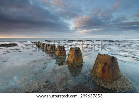 Early morning light over Coledale rock shelf, NSW, Australia - stock photo