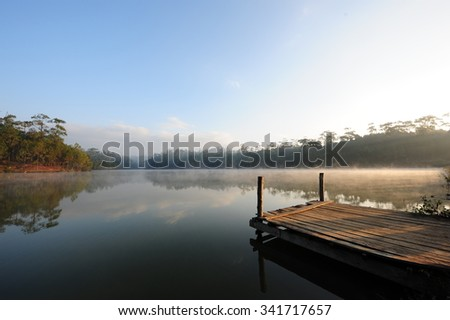 Early morning mist floating over the water at Watchan Royal Project, Chiang Mai (Thailand) - stock photo