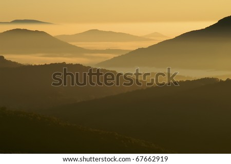 Early Morning Misty Mountains of North Carolina Horizontal With Copy Space - stock photo
