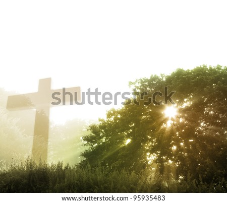 Early morning rays of sunlight and religious cross. Copy space - stock photo