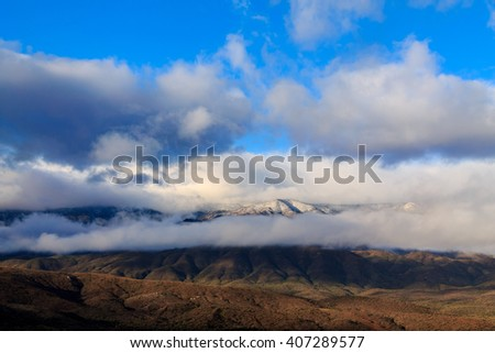Early morning storm clouds traveling low over Arizona's Mogollon Rim plateau - stock photo