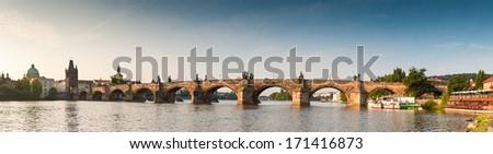 Early morning sunlight illuminating Charles Bridge (1357) in the magical city of Prague. - stock photo