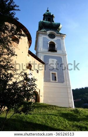 Early morning sunlight on old town of Banska Stiavnica, Slovakia - stock photo