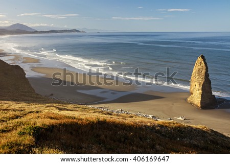 Early morning sunrise on the Oregon coast overlooking a calm Pacific Ocean. - stock photo