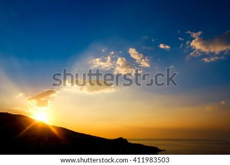 Early morning , sunrise over mountain. Picturesque view of beautiful sunrise at black sea. Gold sea sunrise landscape. Amazing sunrise background. Sunrise sea postcard. New day concept. - stock photo