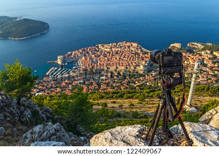 Early morning sunrise shoting timelapse  panorama of Dubrovnik old city defense walls. Location Croatia - Europe. Focus on camera. - stock photo