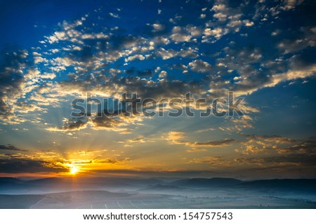 Early morning, the sun rises, the fog. natural landscape - stock photo