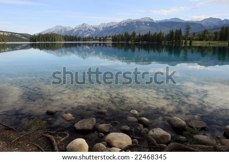 Early morning view of lake Beauvert in Jasper Canada - stock photo