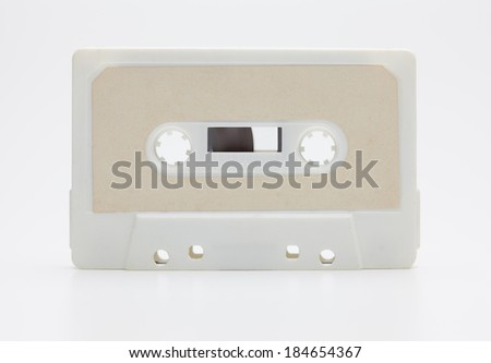 Early 70's cassette tape isolated on natural white background, with slight reflection.  - stock photo