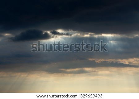 Early spring cloudy sky with natural sunbeams - stock photo