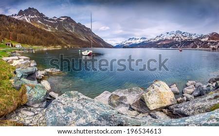Early Spring on the lake Lej da Segl. Alps, Switzerland. - stock photo