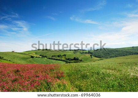 Early summer landscape from center Italy with cultivated fields and blue sky - stock photo