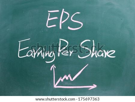 earning per share written on blackboard  - stock photo