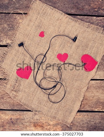earphones and hearts, love the music - stock photo