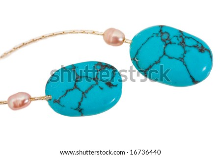 earring from decorative stone expressed on white background - stock photo