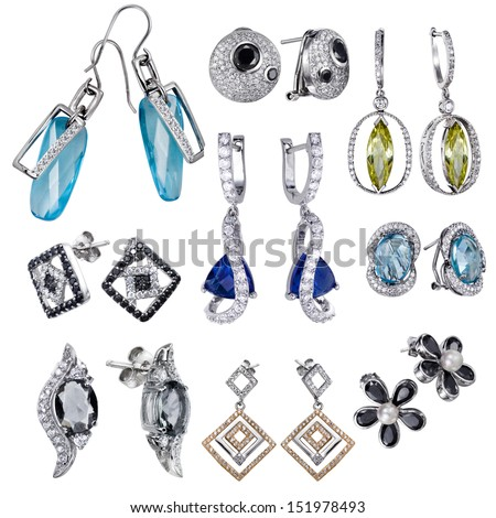 Earrings with white zircon and expensive big blue  gemstones - stock photo