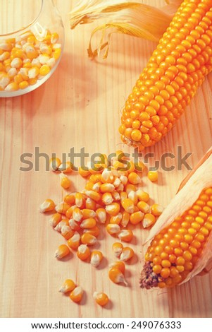 ears of corn on wooden boards instagram stile  - stock photo