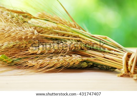 ears of wheat on the table - stock photo